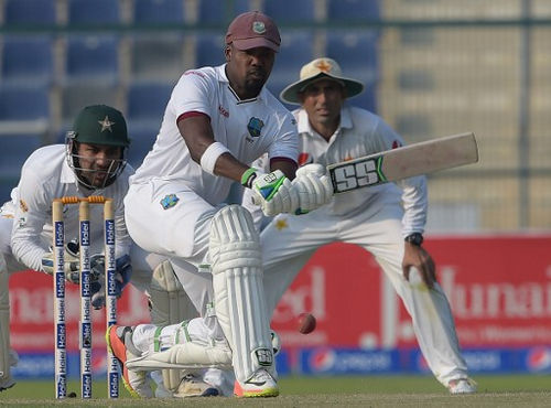 Photo: West Indies batsman Darren Bravo (centre) prepares to play a shot on the second day of the second Test between Pakistan and West Indies at the Sheikh Zayed Cricket Stadium in Abu Dhabi on 22 October 2016. (Copyright AFP 2017/Aamir Qureshi)