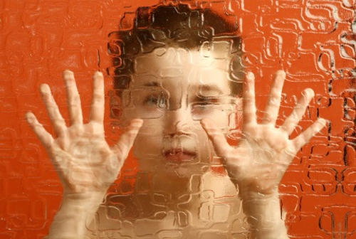 Photo: A depiction of a child with Asperger's Syndrome.