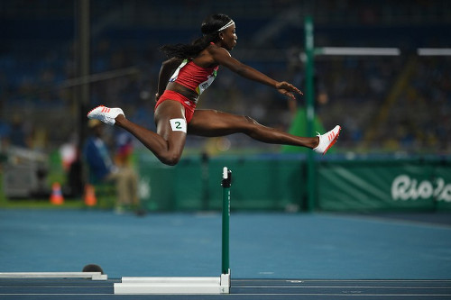 Photo: Trinidad and Tobago's Janeil Bellille competes in the Women's 400m Hurdles Semifinal during the Rio 2016 Olympic Games at the Olympic Stadium in Rio de Janeiro on 16 August 2016. (Copyright AFP 2017/Johannes Eisele)