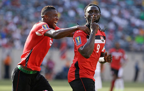 Photo: Trinidad and Tobago forward Kenwyne Jones (right) celebrates with teammate Sheldon Bateau during international duty at the 2015 CONCACAF Gold Cup.