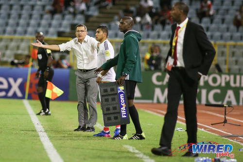 Photo: Mexico coach Juan Carlos Osorio (left) complains to the fourth official while Trinidad and Tobago coach Dennis Lawrence (right) follows the action during Russia 2018 World Cup qualifying action at the Hasely Crawford Stadium on 28 March 2017. Mexico won 1-0. (Courtesy Chevaughn Christopher/Wired868)