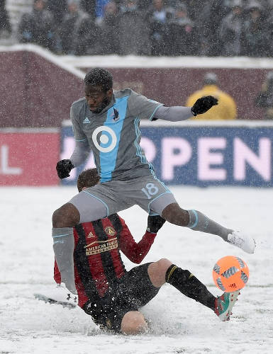 Photo: Minnesota United FC midfielder Kevin Molino jumps over Atlanta United FC player Chris McCann during their MLS contest on 12 March 2017 at TCF Bank Stadium in Minneapolis, Minnesota. Atlanta defeated Minnesota 6-1. (Copyright AFP 2017/Hannah Foslien/Getty Images)