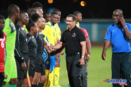 Photo: SPORTT CEO Adam Montserin (centre) greets players and officials before kick off between Trinidad and Tobago and Barbados at the Ato Boldon Stadium in Couva on 10 March 2017. TTFA vice-president Ewing Davis (right) broke away from the customary pre-game ritual to take a phone call. (Copyright CAI Images/Wired868)