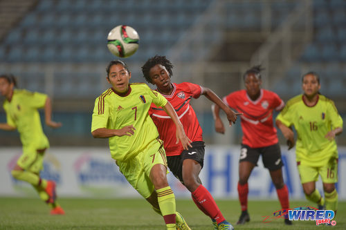 Photo: Venezuela midfielder Milagros Mendoza (foreground) looks to initiate an attack while Trinidad and Tobago midfielder Ranae Ward (centre) stays close during international friendly action at the Ato Boldon Stadium in Couva on 29 March 2017. Venezuela won 3-1. (Courtesy Chevaughn Christopher/Wired868)