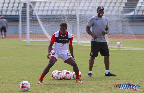 Photo: Trinidad and Tobago National Senior Team assistant coach Stern John (right) throws an eye on forward Akeem Roach during training at the Larry Gomes Stadium in Malabar on 8 March 2017. (Courtesy Sean Morrison/Wired868)