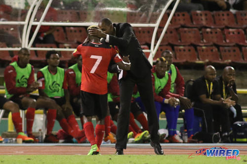 Photo: Trinidad and Tobago National Senior Team head coach Dennis Lawrence (right) thanks midfielder Cordell Cato for his effort during 2018 World Cup qualifying action against Panama at the Hasely Crawford Stadium on 24 March 2017. (Courtesy Chevaughn Christopher/Wired868)