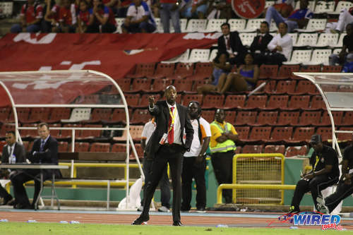 Photo: Trinidad and Tobago National Senior Team coach Dennis Lawrence (centre) makes a point to his players during World Cup qualifying action against Panama at the Hasely Crawford Stadium on 24 March 2017. (Courtesy Chevaughn Christopher/Wired868)