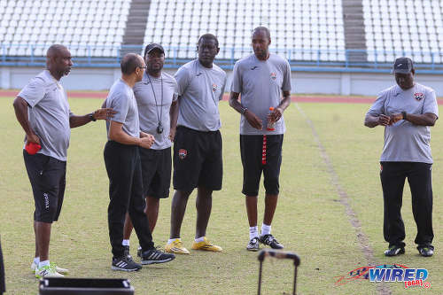 Photo: Trinidad and Tobago National Senior Team head coach Dennis Lawrence (second from right) talks tactics with his coaching staff (from right) Stuart Charles-Fevrier, Ross Russell, Stern John, Richard Piper and Michael Williams. (Courtesy Sean Morrison/Wired868)