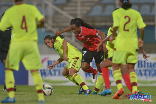 Photo: Trinidad and Tobago playmaker Dernelle Mascall (centre) drives towards the Venezuela goal during international friendly action at the Ato Boldon Stadium in Couva on 29 March 2017. Venezuela won 3-1. (Courtesy Chevaughn Christopher/Wired868)