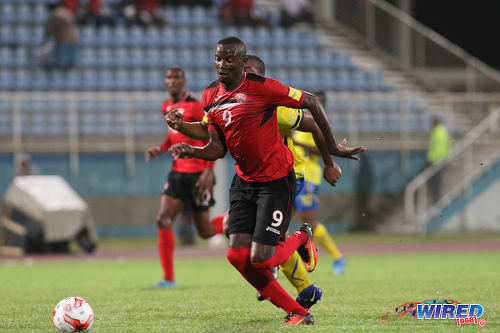 Photo: Trinidad and Tobago National Senior Team forward Jameel Perry chases the ball during international friendly action against Barbados at the Ato Boldon Stadium in Couva on 10 March 2017.  T&T won 2-0 on two goals from substitute forward Jamille Boatswain.  (Courtesy Chevaughn Christopher/Wired868)