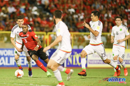Photo: Trinidad and Tobago winger Joevin Jones (second from left) takes on the Mexico defence during 2018 FIFA World Cup qualifying action at the Hasely Crawford Stadium in Port of Spain on 28 March 2017. (Courtesy Chevaughn Christopher/Wired868)