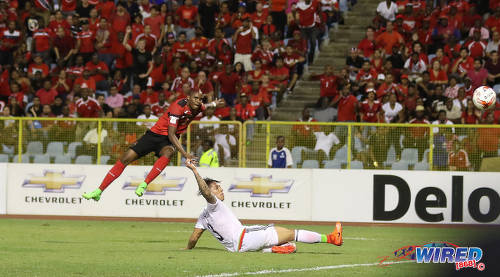 Photo: Trinidad and Tobago midfielder Joevin Jones (left) blasts the ball into the back of the net while Mexico defender Carlos Salcedo looks on during Russia 2018 World Cup qualifying action at the Hasely Crawford Stadium on 28 March 2017. Jones' item was incorrectly ruled out for offside as T&T lost 1-0 to Mexico. (Courtesy Sean Morrison/Wired868)