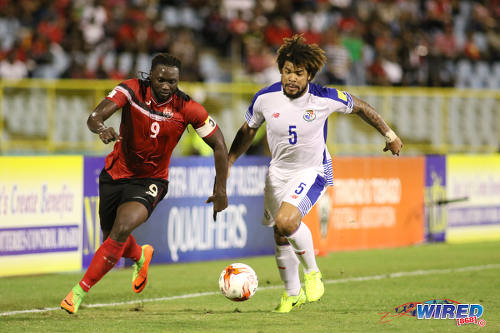 Photo: Trinidad and Tobago forward Kenwyne Jones (left) outruns Panama central defender Roman Torres during 2018 World Cup qualifying action at the Hasely Crawford Stadium on 24 March 2017. (Courtesy Chevaughn Christopher/Wired868)
