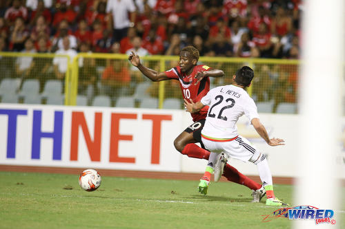 Photo: Trinidad and Tobago midfielder Kevin Molino (left) eludes Mexico left back Luis Reyes during Russia 2018 World Cup qualifying action at the Hasely Crawford Stadium on 28 March 2017. Mexico won 1-0. (Courtesy Chevaughn Christopher/Wired868)