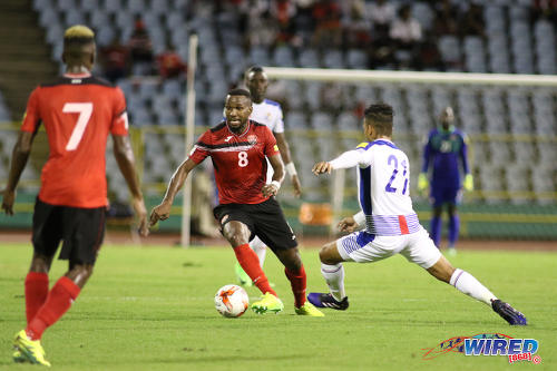 Photo: Trinidad and Tobago midfielder Khaleem Hyland (centre) tries to escape from Panama midfielder Amilcar Henriquez (right) during 2018 World Cup qualifying action at the Hasely Crawford Stadium on 24 March 2017. (Courtesy Chevaughn Christopher/Wired868)