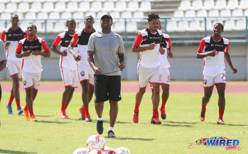 Photo: Trinidad and Tobago National Senior Team assistant coach Stern John (foreground) leads the squad in training at the Larry Gomes Stadium in Malabar on 8 March 2017. (Courtesy Sean Morrison/Wired868)