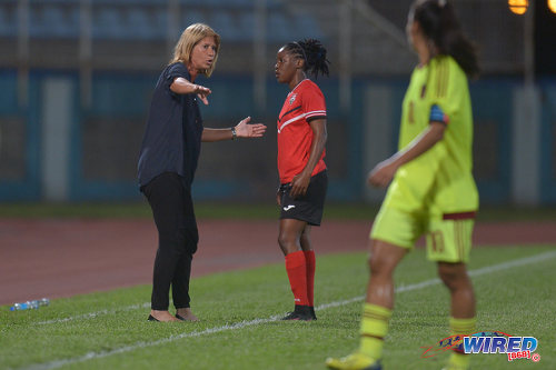 Photo: Trinidad and Tobago Women's National Senior Team head coach Carolina Morace (left) makes a point to attacker Shenelle Henry during international friendly action against Venezuela at the Ato Boldon Stadium in Couva on 29 March 2017. (Courtesy Chevaughn Christopher/Wired868)