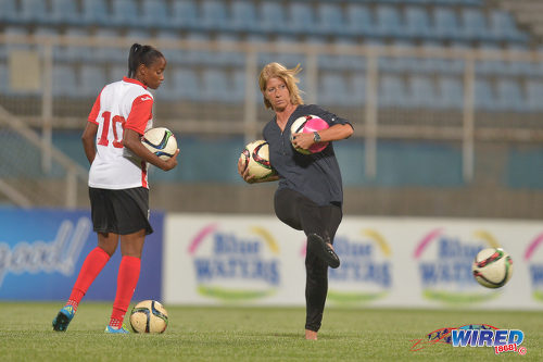 Photo: Trinidad and Tobago Women's National Senior Team head coach Carolina Morace (right) and captain Tasha St Louis warm up before kick off against Venezuela in international friendly action at the Ato Boldon Stadium in Couva on 29 March 2017. (Courtesy Chevaughn Christopher/Wired868)
