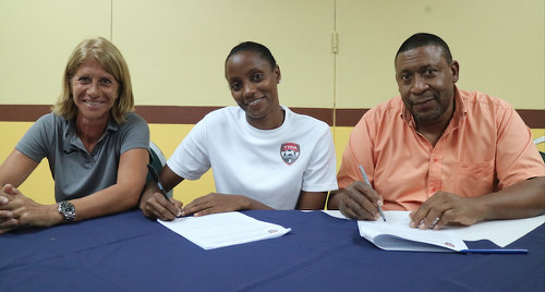 Photo: Trinidad and Tobago Women's National Senior Team captain Tasha St Louis (centre) signs a one year monthly retainer contract alongside TTFA president David John-Williams (right) and head coach Carolina Morace on 27 March 2017. (Copyright TTFA Media)
