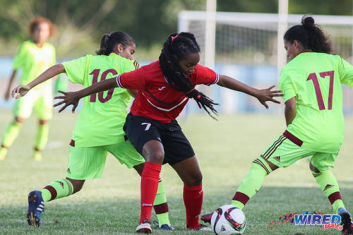 Photo: Trinidad and Tobago Women's National Senior Team midfielder Dernelle Mascall (centre) tries to hold off Venezuela players Maikerlin Astudillo (left) and Yeiny Rosal during international friendly action at the Ato Boldon Stadium in Couva on 26 May 2017. (Courtesy Chevaughn Christopher/Wired868)