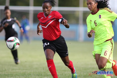 Photo: Trinidad and Tobago Women's National Senior Team attacker and captain Tasha St Louis (left) takes on Venezuela defender Rafanny Mendoza during international friendly action at the Ato Boldon Stadium in Couva on 26 May 2017. (Courtesy Chevaughn Christopher/Wired868)