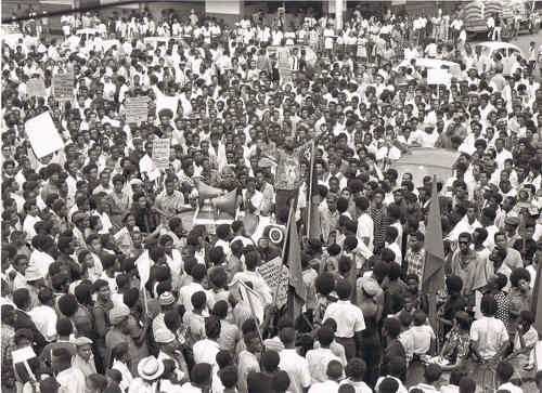 Photo: NJAC chief servant Makandal Daaga addresses the crowd in Port of Spain on 21 April 1970. (Courtesy NJAC)