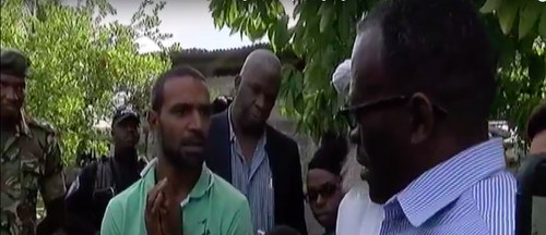 "Photo: National Security Minister Edmund Dillon (right) trolls gang member Abdul ""Krysis"" Wakeel on his home turf in Crown Trace while Deputy Commissioner (Crime) Wayne Dick (background) looks on."