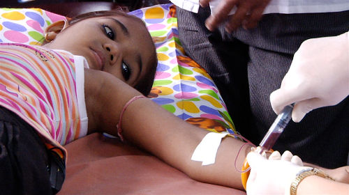 Photo: A girl receives a blood transfusion.