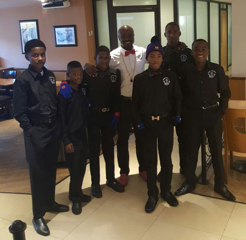 Photo: Members of the Crown Trace FC U-13 team and founder Nicholas Griffith en route to the New Balance Easter International Cup in Manchester. (Courtesy Crown Trace FC)