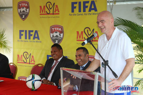 Photo: FIFA president Gianni Infantino (right) charms SPORTT chairman Michael Phillips (centre) and Sport Minister Darryl Smith at a press conference at the Ato Boldon Stadium in Couva on 10 April 2017. (Courtesy Sean Morrison/Wired868)