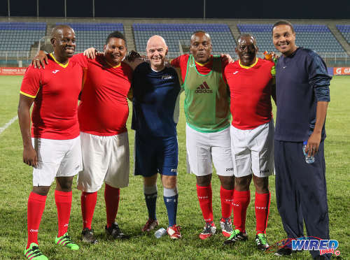 Photo: FIFA president Gianni Infantino (centre) poses with Sport Minister Darryl Smith (second from left), National Security Minister Edmund Dillon (second from right) and Speaker of the House Esmond Forde (third from right) after an exhibition match at the Ato Boldon Stadium in Couva on 10 April 2017. (Courtesy Sean Morrison/Wired868)