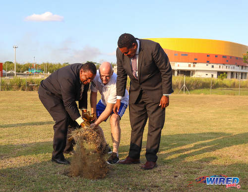Photo: FIFA president Gianni Infantino (centre) and TTFA president David John-Williams (left) turn the sod at the Ato Boldon Stadium in Couva while Sport Minister Darryl Smith pretends to help on 10 April 2017. (Courtesy Sean Morrison/Wired868)