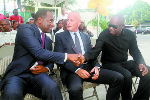 Photo: Sunny Group of Companies CEO John Wallis (centre) looks on as Dominica Prime Minister Roosevelt Skerrit (left) and Ma Pau St Kitts and Nevis managing director, Fitz Fulton, exchange greetings on 20 April 2012.