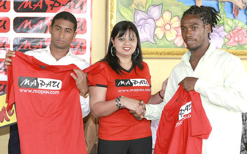 Photo: Ma Pau casino's human resource manager Sherry Persad (centre) presents Ma Pau SC jerseys to footballers Elton John (right) and Shane Calderon during a press conference at the Sweet Lime Restaurant on Ariapita Avenue, Woodbrook on 24 January 2012. (Copyright Trinidad Guardian/Anthony Harris)