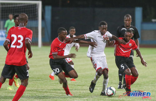 Photo: Republic Bank XI attacker Keron Manswell (centre) holds off Trinidad and Tobago National Under-15 players Tristan Caesar (left) and Jarique Williams during action at the Ato Boldon Stadium on 15 April 2017. (Courtesy Sean Morrison/Wired868)