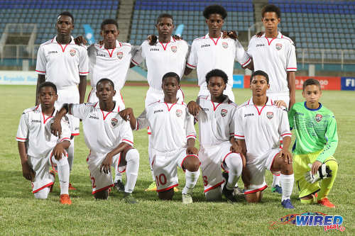 Photo: The Republic Bank Invitational XI pose before an exhibition match against the Trinidad and Tobago National Under-15 Team on 15 April 2017 at the Ato Boldon Stadium. (Courtesy Sean Morrison/Wired868)