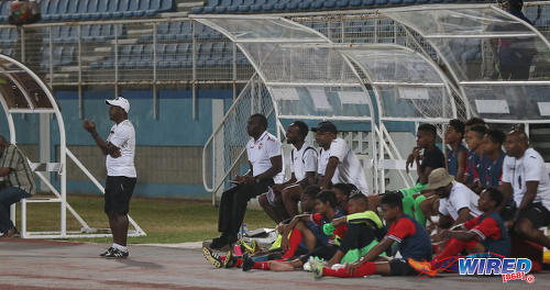 Photo: Trinidad and Tobago National Under-15 Team coach Russell Latapy (left) likes what he sees during an exhibition match at the Ato Boldon Stadium on 15 April 2017. (Courtesy Sean Morrison/Wired868)