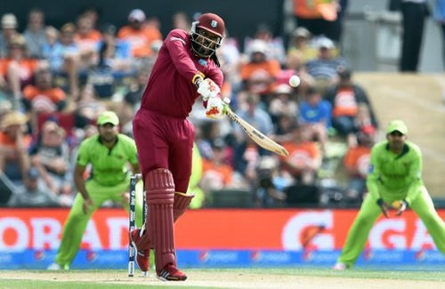 Photo: West Indies batsman Chris Gayle (centre) hits out against the Pakistan bowling during their 2015 Cricket World Cup Group B match in Christchurch on 21 February 2015. (Copyright AFP 2017/William West)