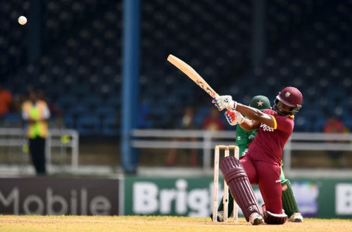 Photo: West Indies' Evin Lewis hits a boundary during the third of four T20I matches against Pakistan at the Queen's Park Oval in Port of Spain, Trinidad, on 1 April 2017.  (Copyright AFP 2017/Jewel Samad)