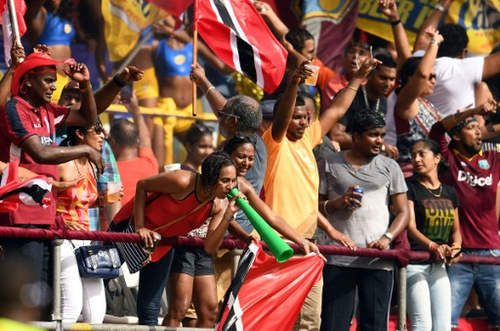 Photo: West Indies' fans cheer during the third of four T20I matches between West Indies and Pakistan at the Queen's Park Oval in Port of Spain, Trinidad, on 1 April 2017. West Indies won the match by 7 wickets, although Pakistan eventually won the series 3-1. (Copyright AFP 2017/Jewel Samad)