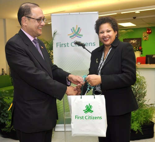 Photo: Then First Citizens Bank chairperson Nyree Alfonso (right) and Minister of Finance and ex-First Citizens CEO Larry Howai. (Copyright Firstcitizenstt)