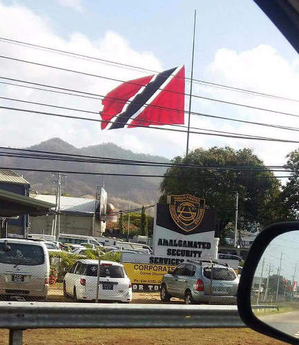 Photo: The Trinidad and Tobago flag flies half-mast at the Amalgamated Security compound in Tunapuna on 8 May 2017. Or did it? Muahahahaha...