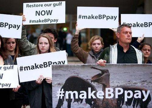 Photo:Activists hold signs during a protest in front of the Hale Boggs Federal Building on the first day of the trial over the Deep Water Horizon oil rig spill on 25 February 2013 in New Orleans, Louisiana. Eleven men were killed during the accident and over 4 million barrels of oil spilled into the Gulf of Mexico in 2010. (Copyright AFP 2017/Sean Gardner/Getty Images)
