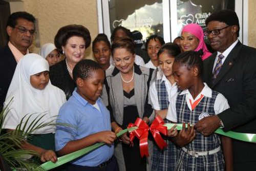 Photo: Then Prime Minister Kamla Persad-Bissessar (centre) assists St Joseph TML and St Joseph Government Primary School students in cutting the ribbon to open officially the Children's Authority Assessment Centre at the Eric Williams Medical Sciences Complex in Mt Hope. Also in photo (from left) are Health Minister Dr Fuad Khan, Children's Authority board chairperson Stephanie Daly SC, Children's Authority director Sharifa Ali-Abdullah and then Minister of Gender, Youth and Child Development Clifton De Coteau. (Copyright Andre Alexander/Trinidad Guardian)