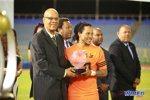 Photo: Acting CFU president Reginaal Francisco (left) presents the Caribbean Club Championship MVP trophy to Cibao and Haiti playmaker Charles Hérold Jr at the Hasely Crawford Stadium on 21 May 2017. (Courtesy Alan V Crane/Wired868)