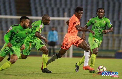 Photo: Cibao FC winger Patrick Soko (centre) charges past Grenades FC players (from right) Zaccheus Polius, Karanja Mack and Blake Thompson during Caribbean Club Championship action at the Hasely Crawford Stadium on 16 May 2017. (Courtesy Nicholas Bhajan/Wired868)