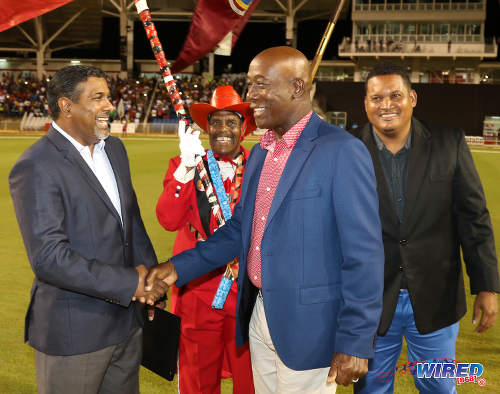 Photo: Prime Minister Keith Rowley (centre) greets SPORTT CEO Dinanath Ramnarine (left) while Sport Minister Darryl Smith (right) looks on during the opening of the Brian Lara Cricket Stadium in Tarouba on 12 May 2017. (Courtesy Sean Morrison/Wired868)