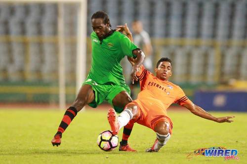 Photo: San Juan Jabloteh winger Nathan Lewis (left) terrorises Cibao FC right back Ernesto Trinidad during the Caribbean Club Championship final on 21 May 2017 at the Hasely Crawford Stadium in Port of Spain. Cibao won 1-0. (Courtesy Allan V Crane/Wired868)