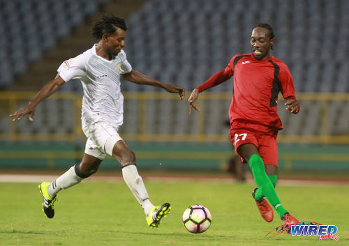 Photo: San Juan Jabloteh winger Nathan Lewis (right) takes on an opponent from Racing Club during 2017 Caribbean Club Championship action at the Hasely Crawford Stadium on 14 May 2017. Lewis scored the opener as Jabloteh won 2-0. (Courtesy Nicholas Bhajan/Wired868)