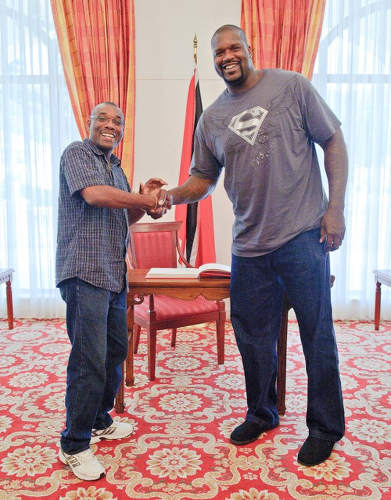 Photo: Former Hoop of Life director and Trinidad Guardian sport editor (left) shakes hands with former NBA star Shaquille O'Neal.